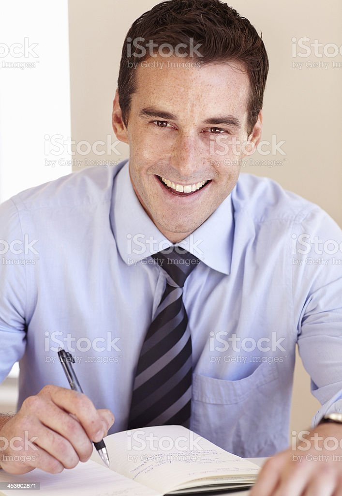 Making sure his dayplanner is filled out stock photo
