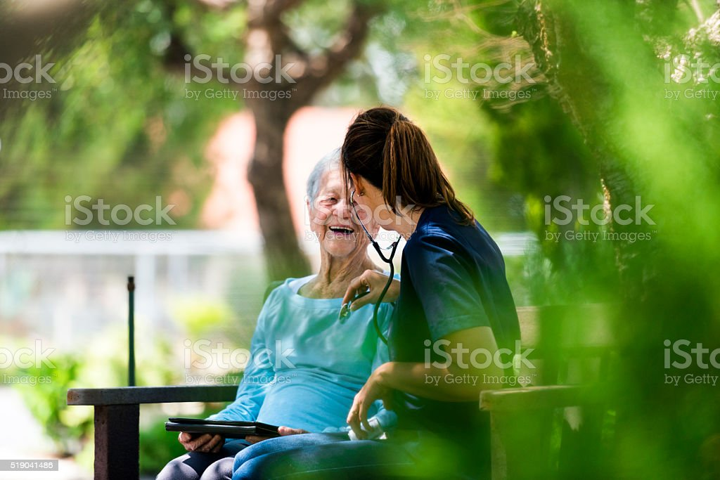 Making Sure My Patient Is Well Taken Care Of stock photo