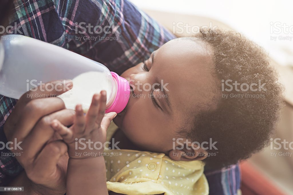 Making sure she gets all the nutrition a growing baby stock photo