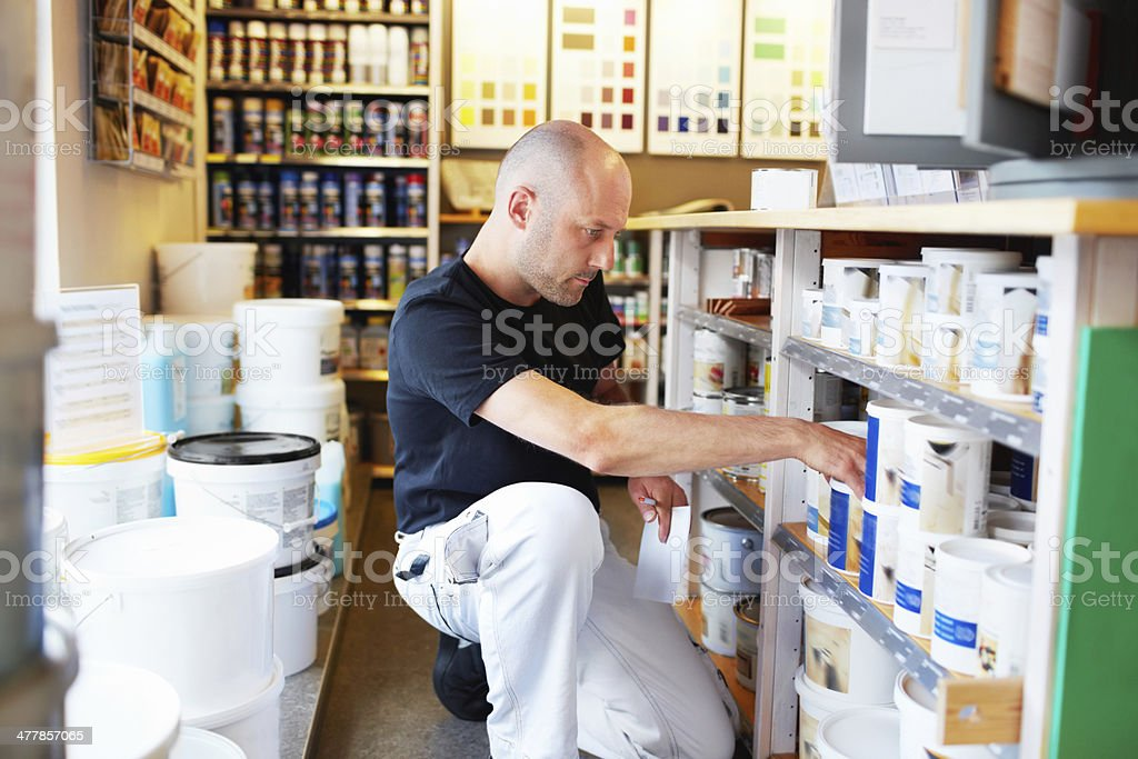 Making sure the shelves are fully stocked royalty-free stock photo