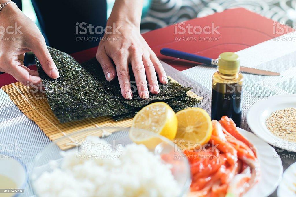 Making sushi at home stock photo
