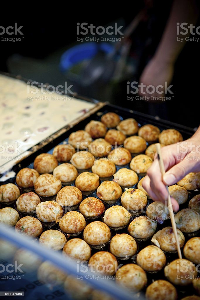 Making Takoyaki - Octopus dumplings stock photo