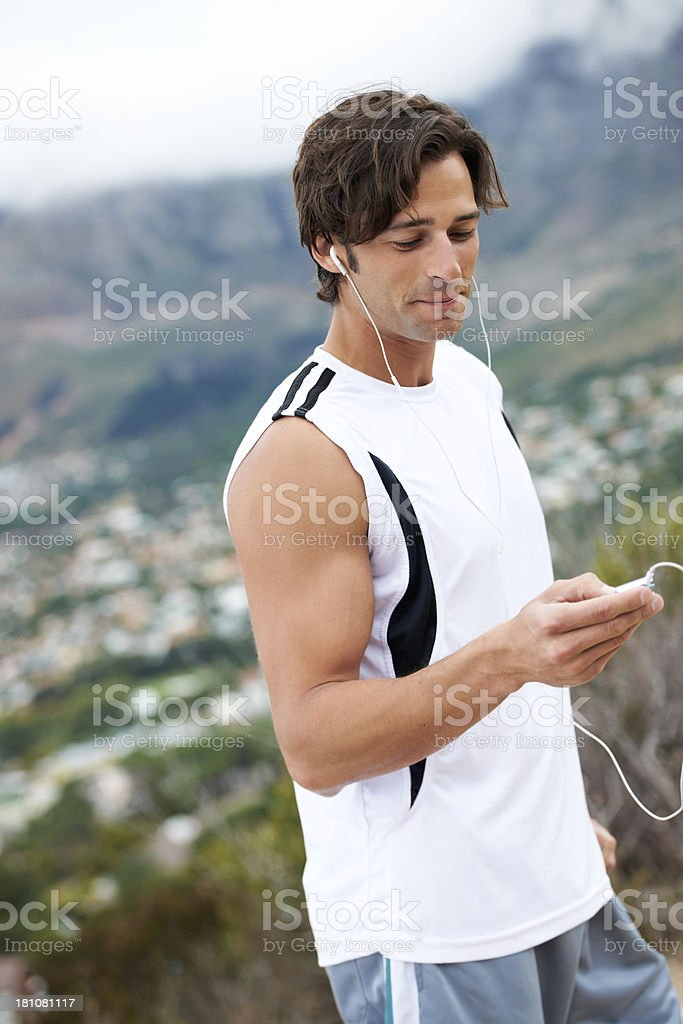 Making the most of a workout with music royalty-free stock photo