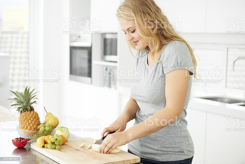 Making the perfect fruit salad stock photo