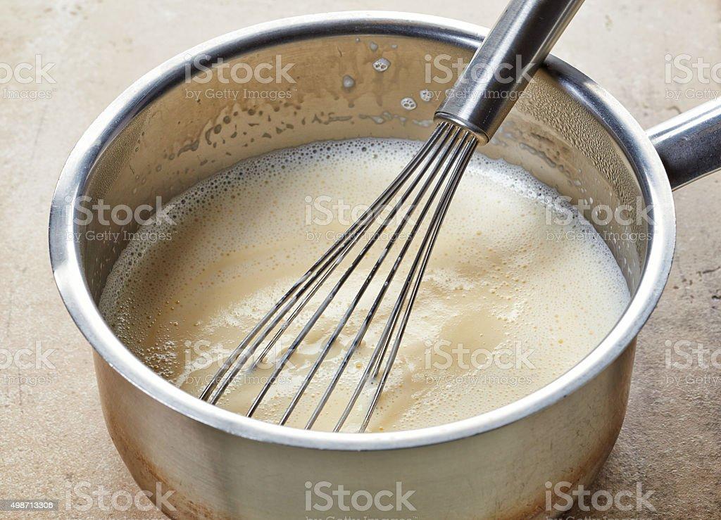 making vanilla sauce in a pot stock photo