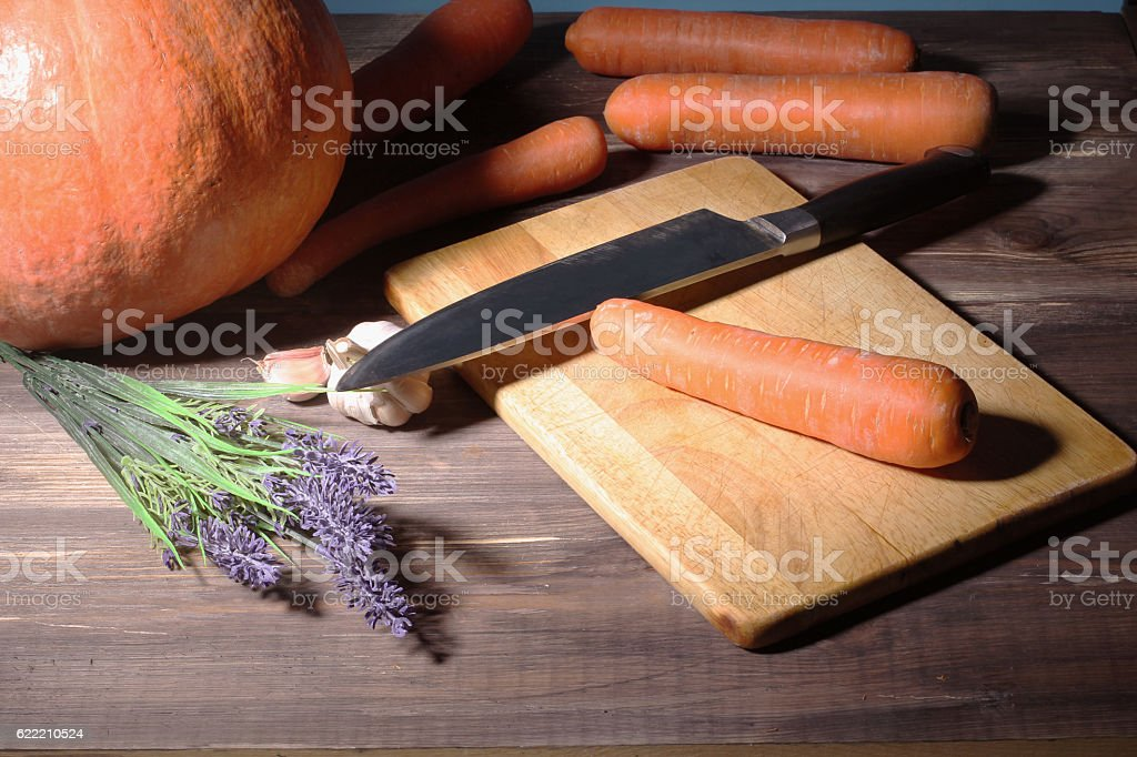 Making vegetable meal. cut all vegetables on cutting board stock photo