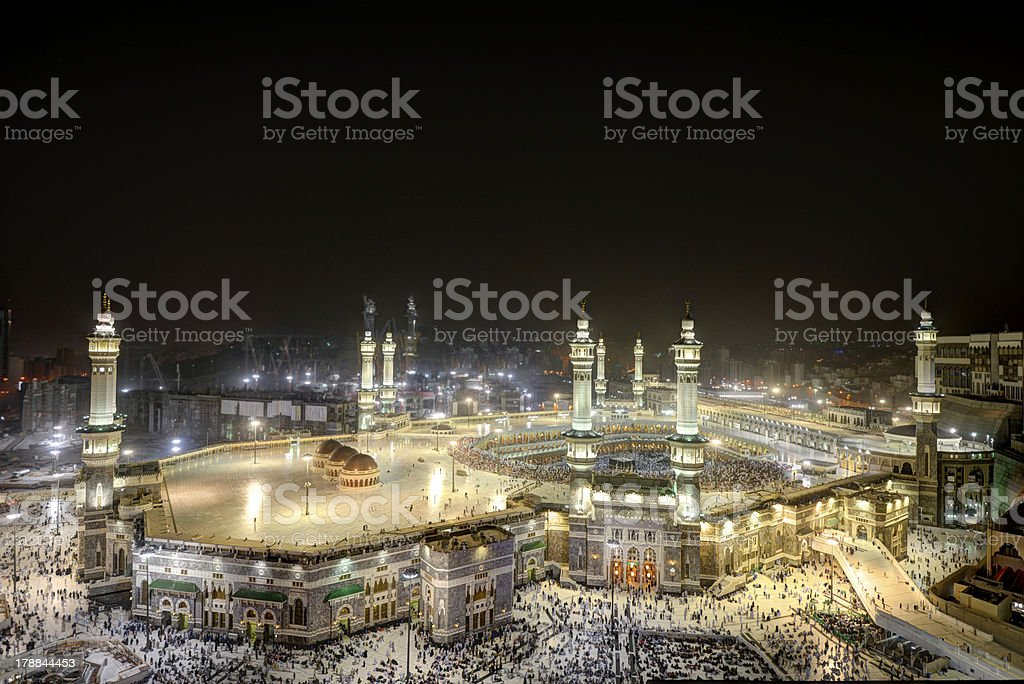 Makkah Kaaba at night with people coming for Haji stock photo