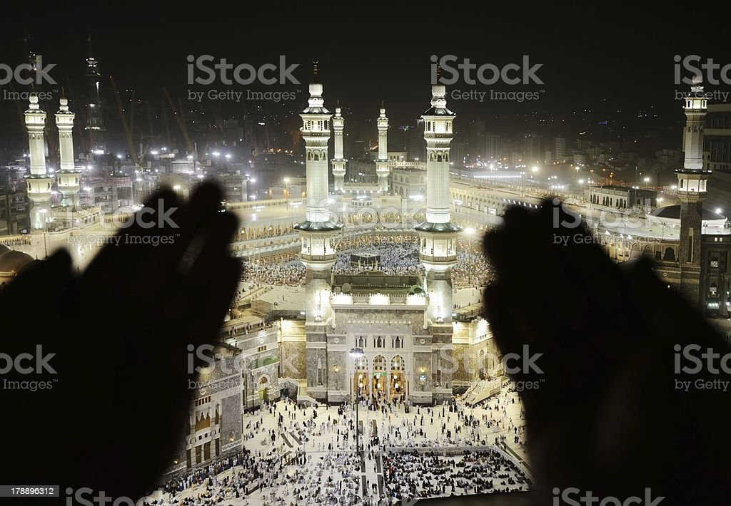 Makkah Kaaba Hajj Muslims, silhouette of hands praying stock photo