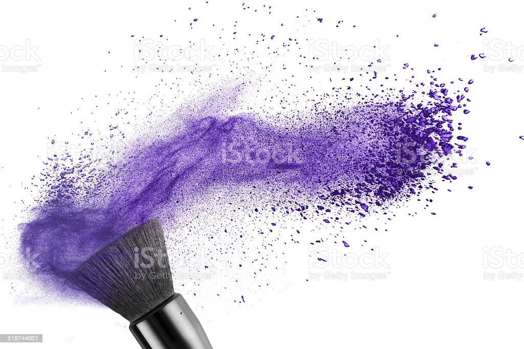 makup brush with blue powder isolated stock photo
