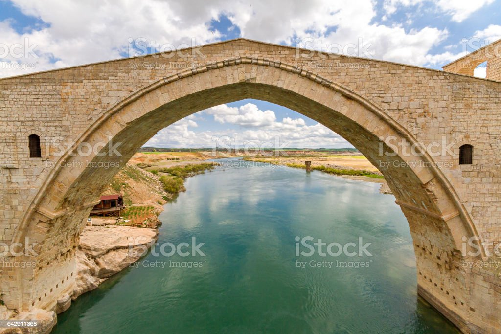Malabadi Bridge in the Southeastern Turkey. The bridge was built in the 12th century by the Turkic dynasty of Artukids. stock photo