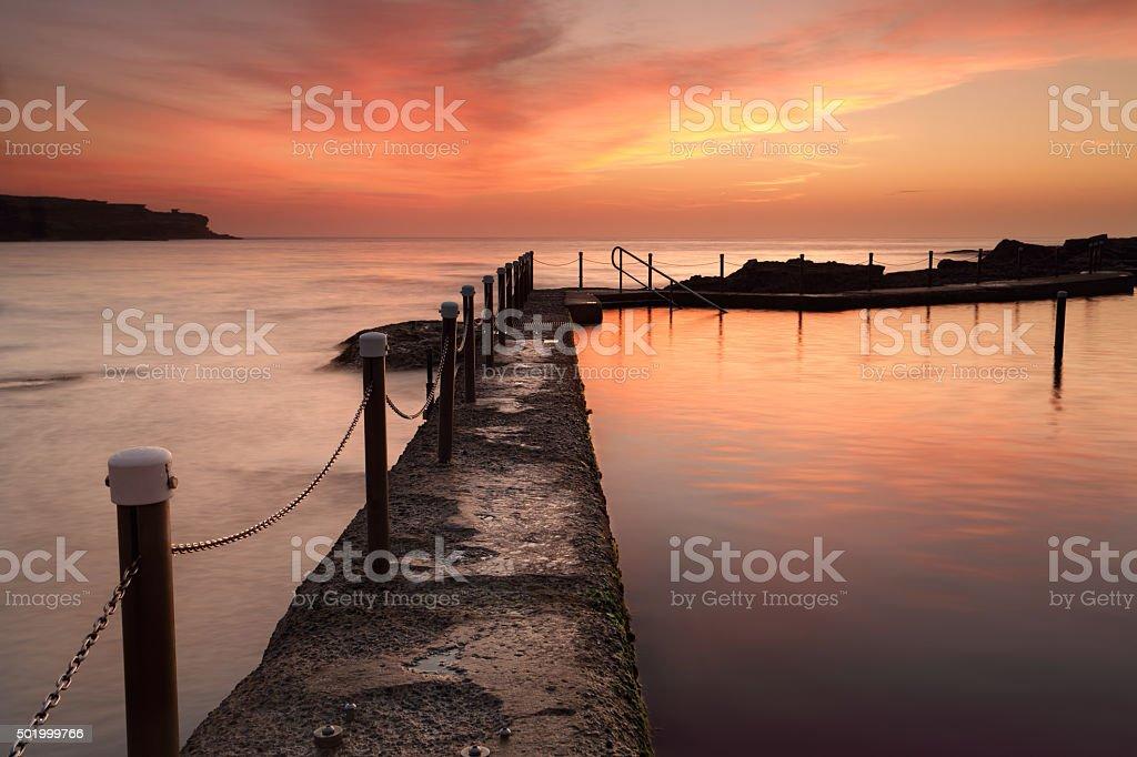 Malabar Ocean Pool at dawn sunrise Australia stock photo