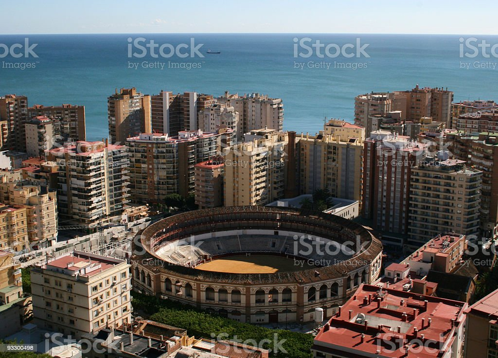 Malaga bullring, blocks, sea and horizon royalty-free stock photo