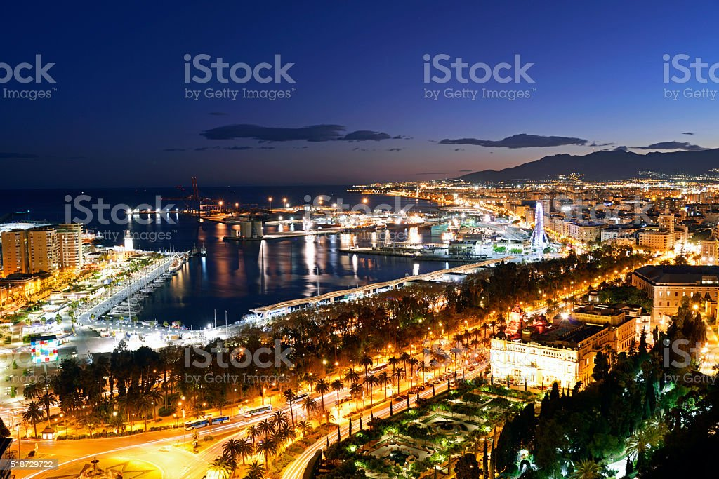 Malaga city and port area at night. stock photo