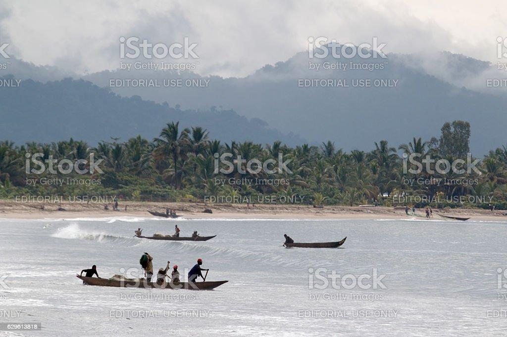 Malagasy fishermen fishing canoe Maroansetra beach Madagascar rainforest mountains stock photo