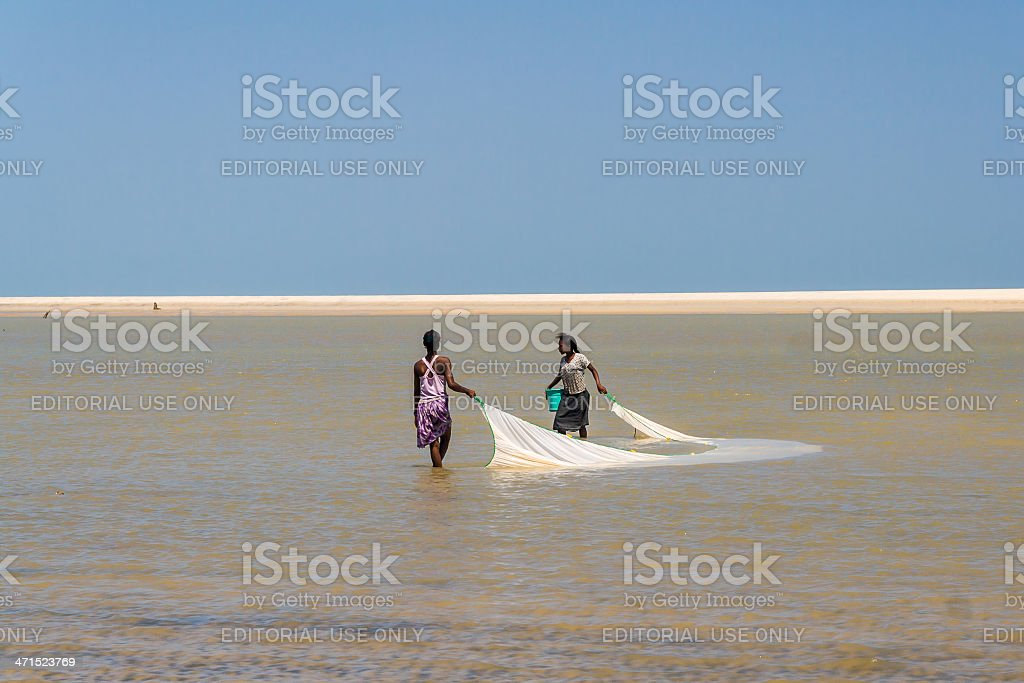 Malagasy women fishing royalty-free stock photo