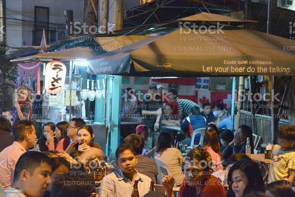 Malate district street drinking nightlife, Manila Philippines stock photo