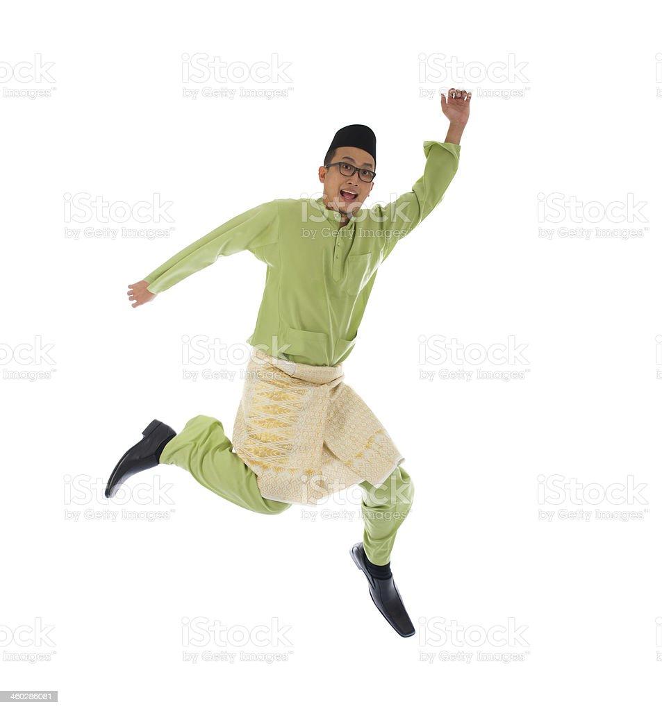 malay male jumping celebrating hari raya eid fitr after ramadan stock photo