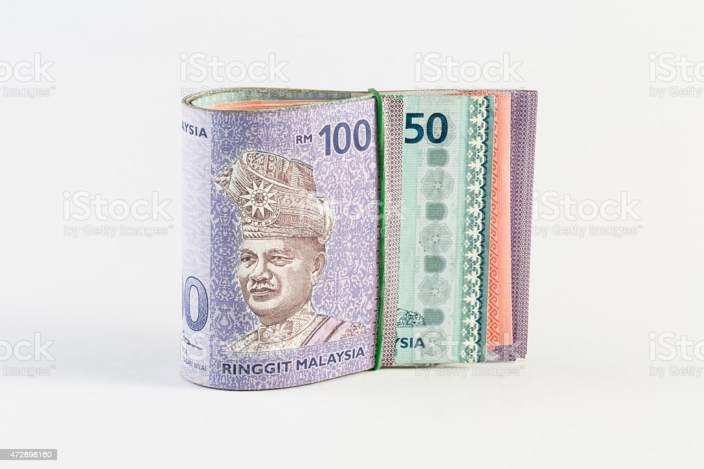 Malaysia Bank Notes under rubber band stock photo