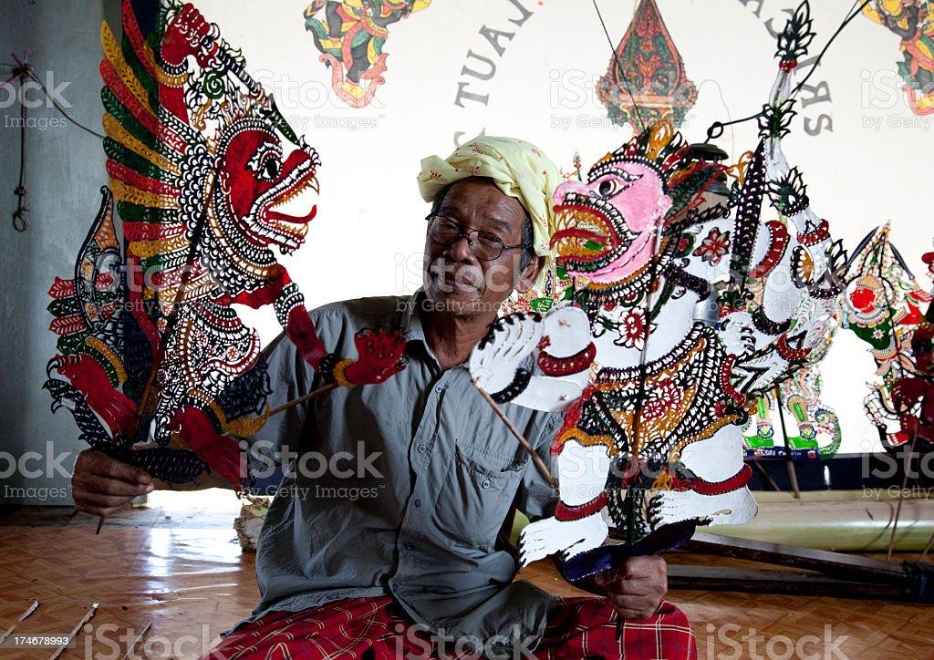 Malaysia, making shadow puppet, wayang kulit. stock photo