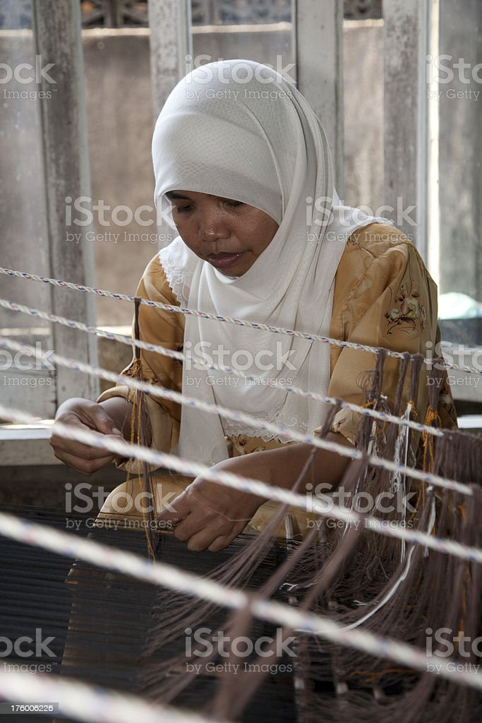 Malaysia,  weaving songket, making colorful clothes. stock photo