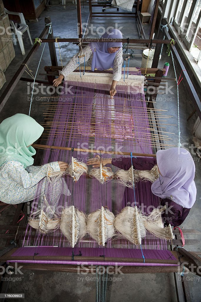Malaysia,  weaving songket, making colorful clothes. royalty-free stock photo