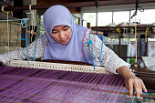 Malaysia,  weaving songket, making colorful clothes.