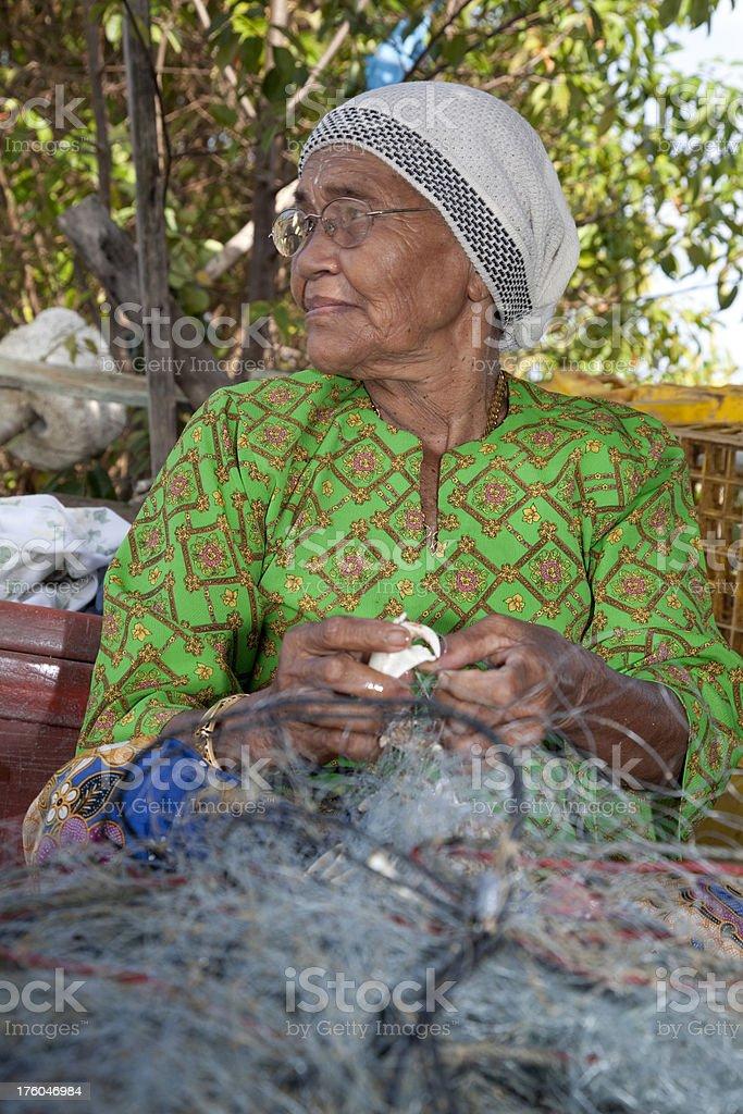 Malaysia, women with fishing net. stock photo