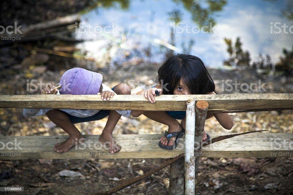 Malaysian kids playing outdoors royalty-free stock photo