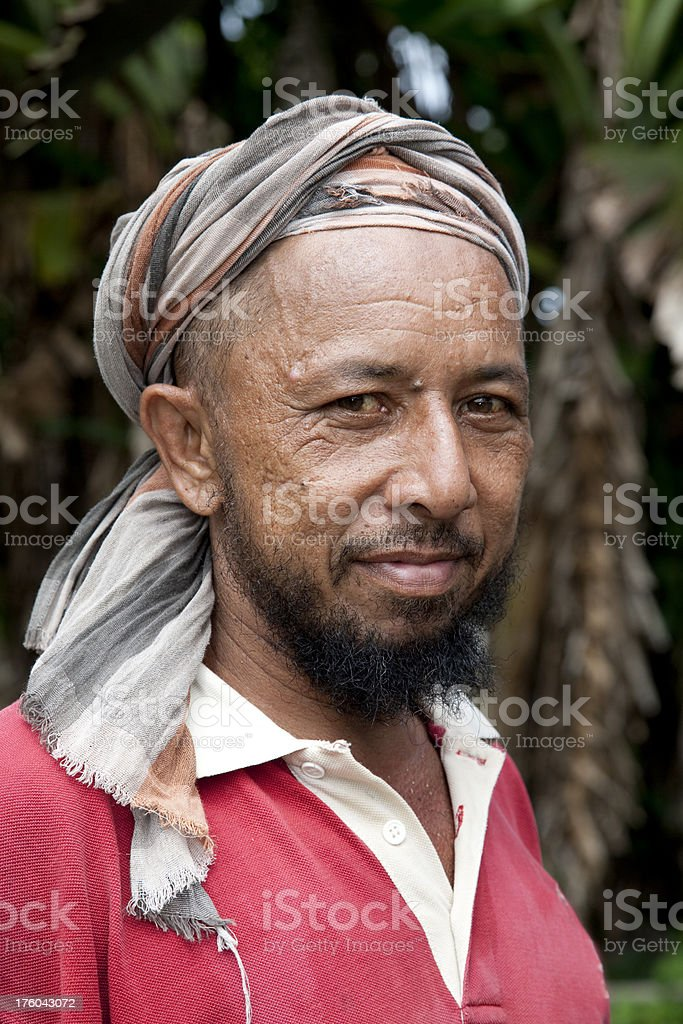 Malaysian person with monkey. stock photo