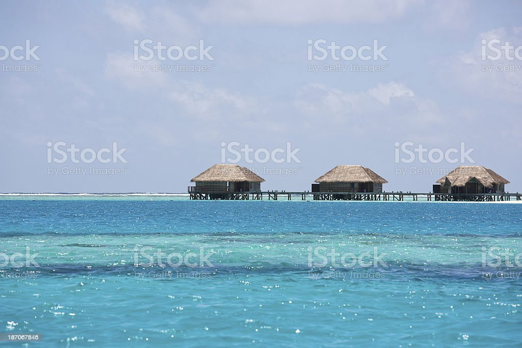 Maldives Islands Private Over Water Bungalows In A Row stock photo