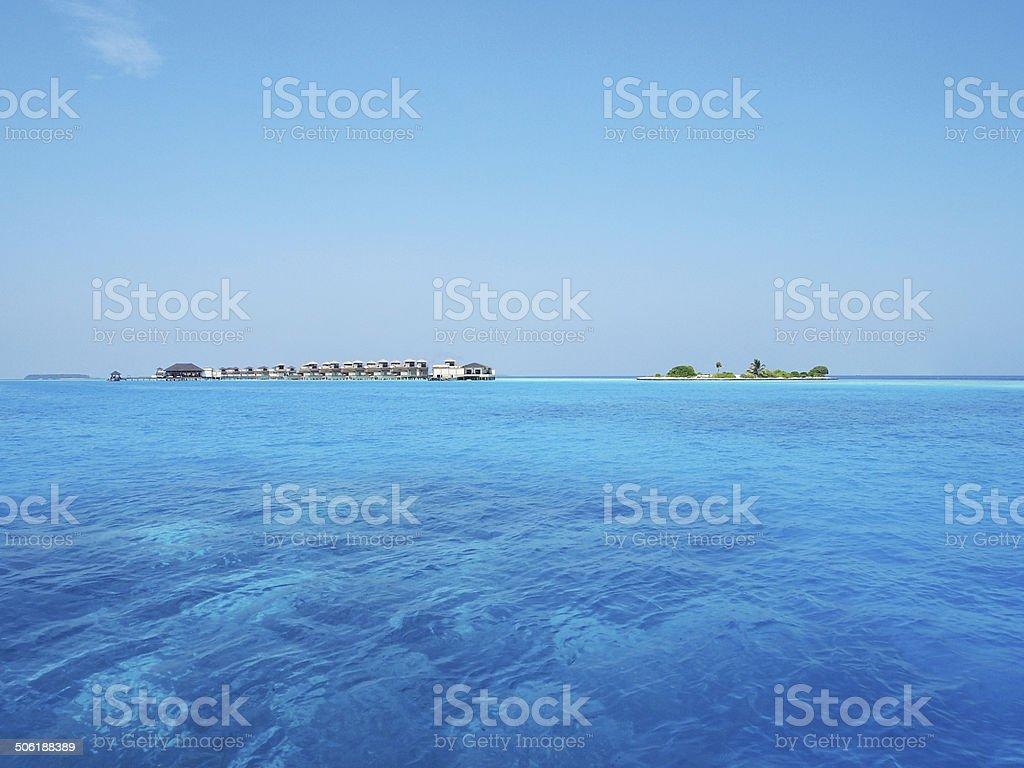 Maldives ocean villa on turquoise water stock photo