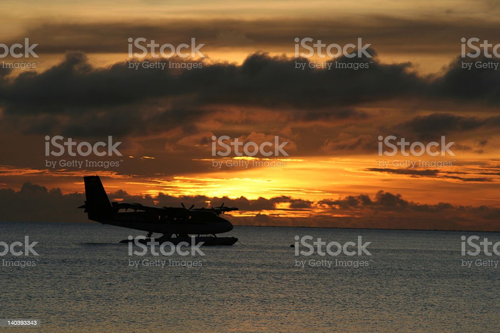 Maldivian Air Taxi in Sunset royalty-free stock photo