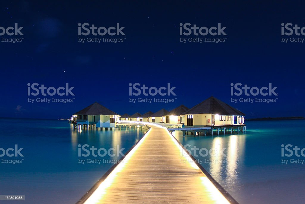 Maldivian Water Villas at Night stock photo