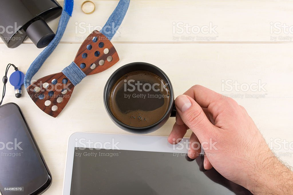 Male accessories with a cup of cofee top view stock photo