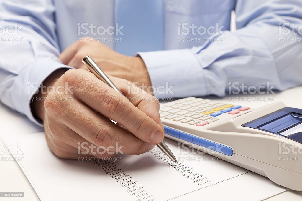 Male accountant calculating taxes stock photo
