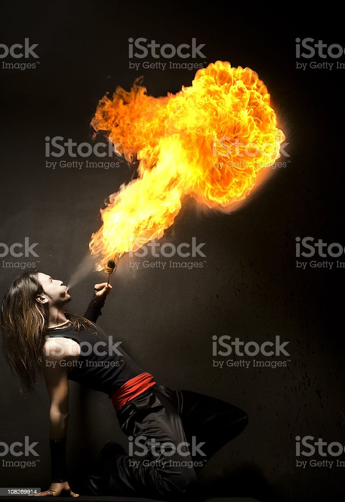 Male Acrobat Blowing Fire stock photo