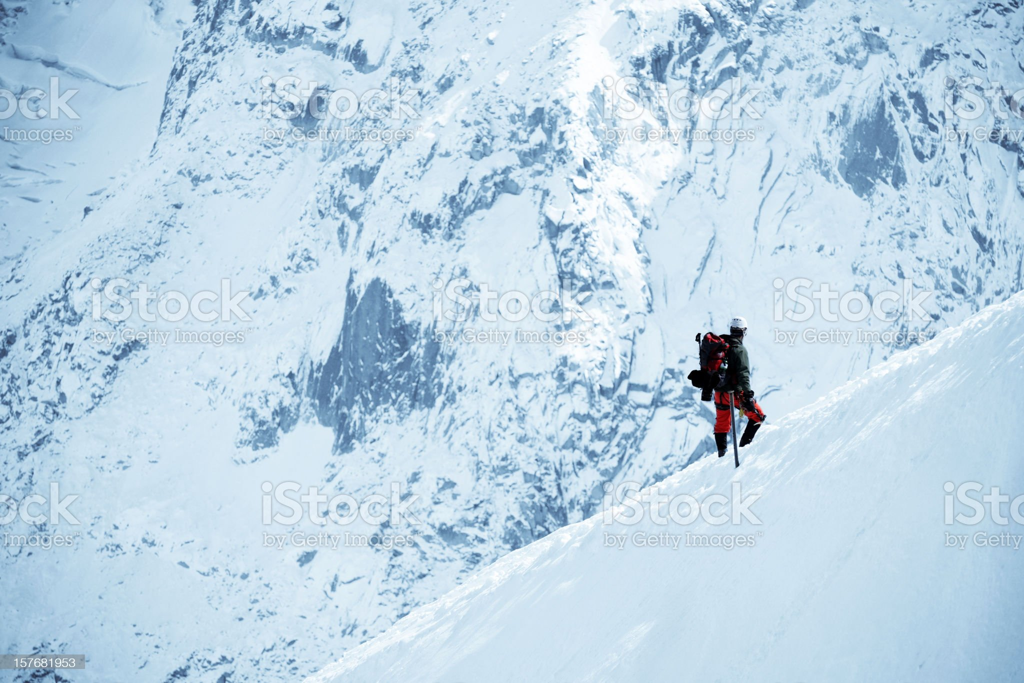 Male Adventurer Walking On Snow Mountain - XLarge royalty-free stock photo
