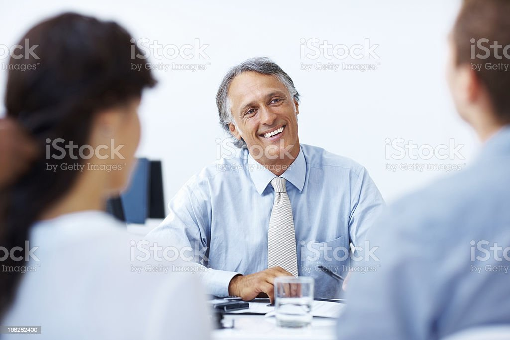 Male advisor discussing with clients in office royalty-free stock photo
