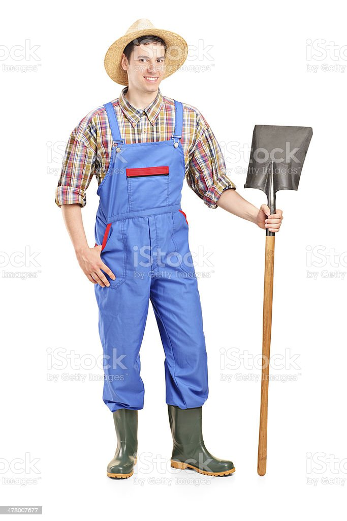 Male agricultural worker holding a shovel royalty-free stock photo