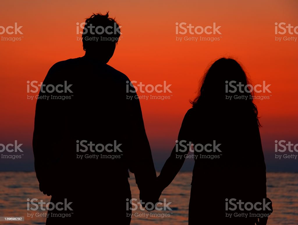 Male and female at sunrise royalty-free stock photo