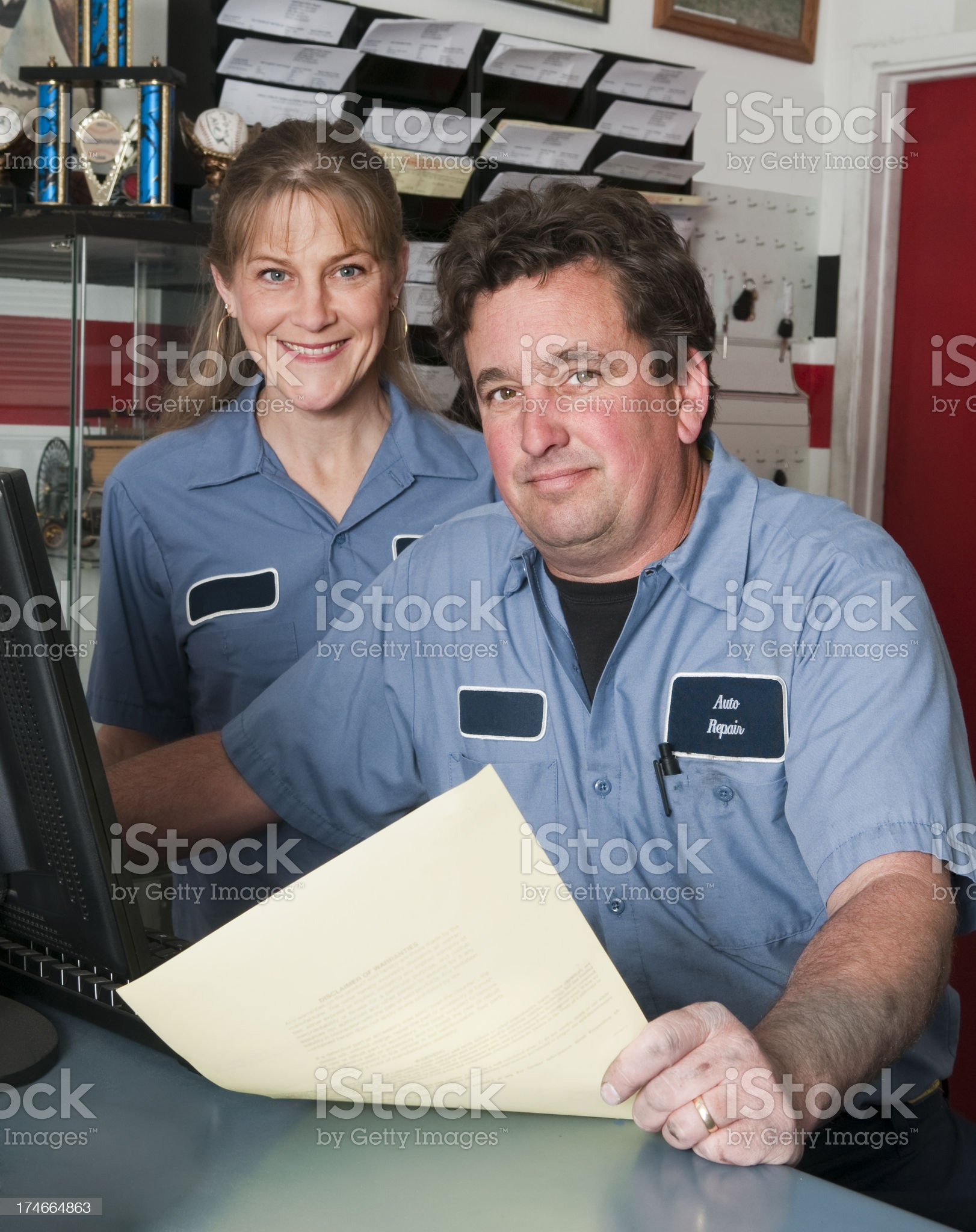 Male and Female Auto Mechanics royalty-free stock photo