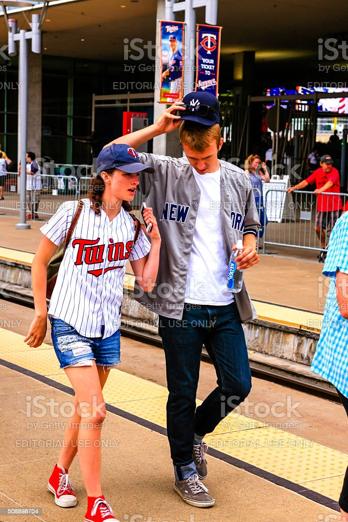 Male and female baseball fans at Target Field Minnesota MN stock photo