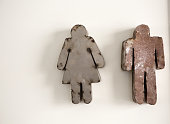 Male And Female Bathroom Symbols Cut From Metal