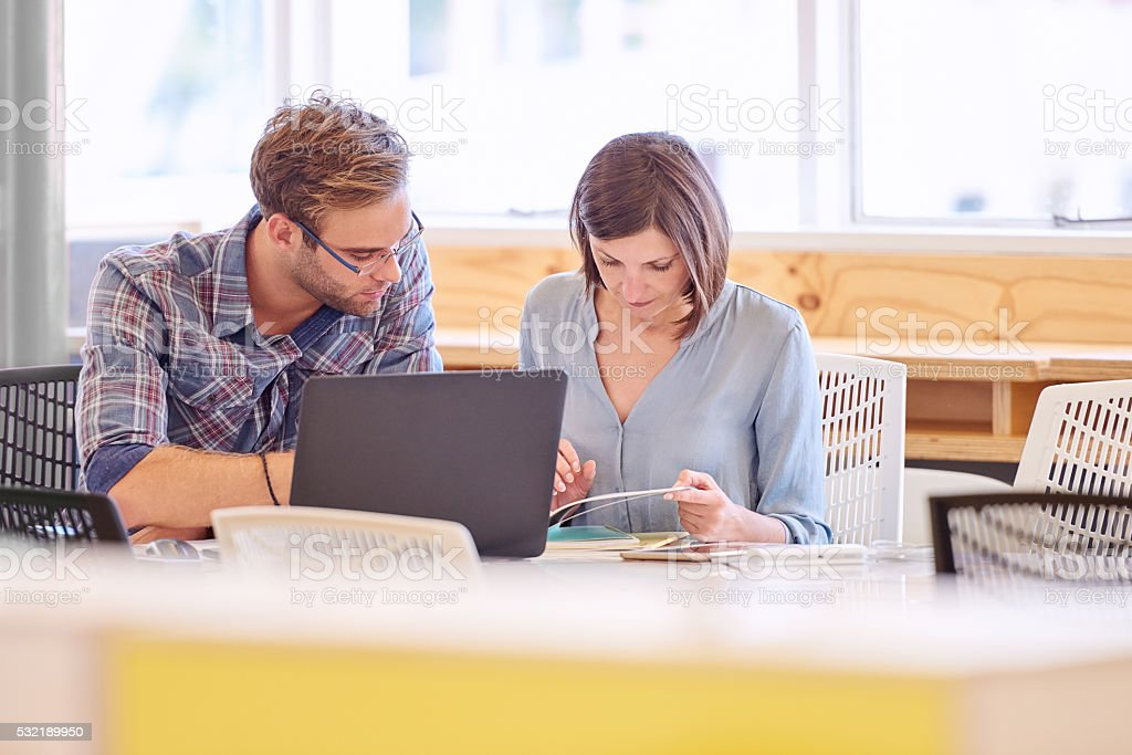 Male and female business professionals working together in office stock photo