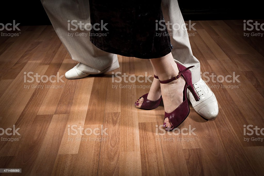 Male and female couple doing the steps of a Tango dance royalty-free stock photo