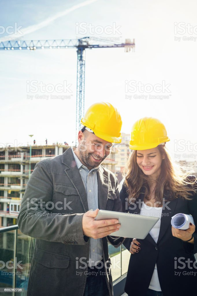 Male and female employees working together stock photo