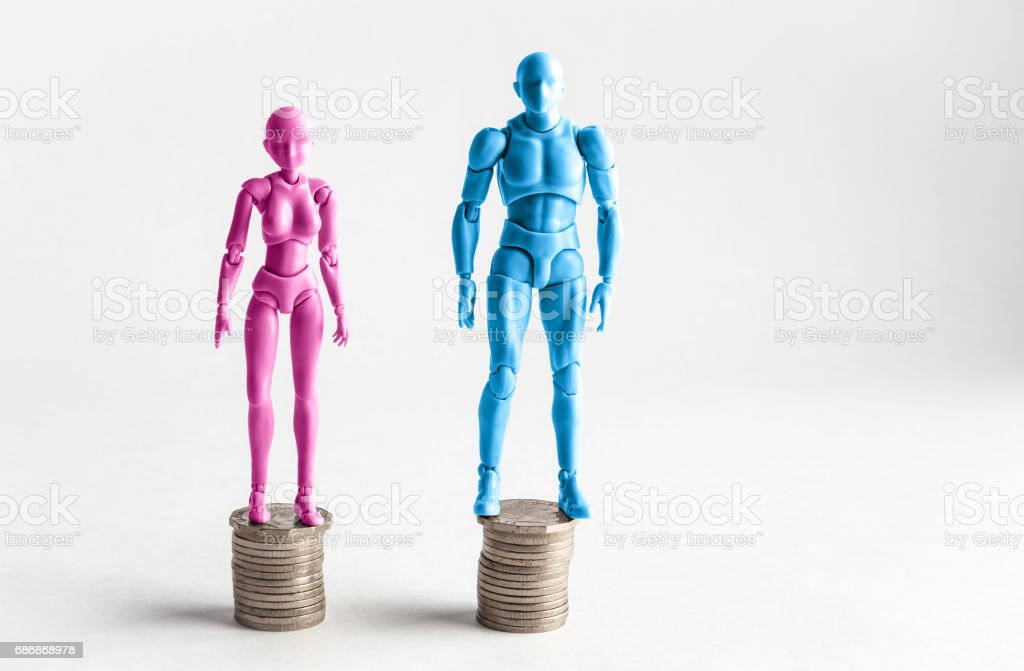 Male and female figurines standing next to equal piles of coins. Income equality concept. stock photo