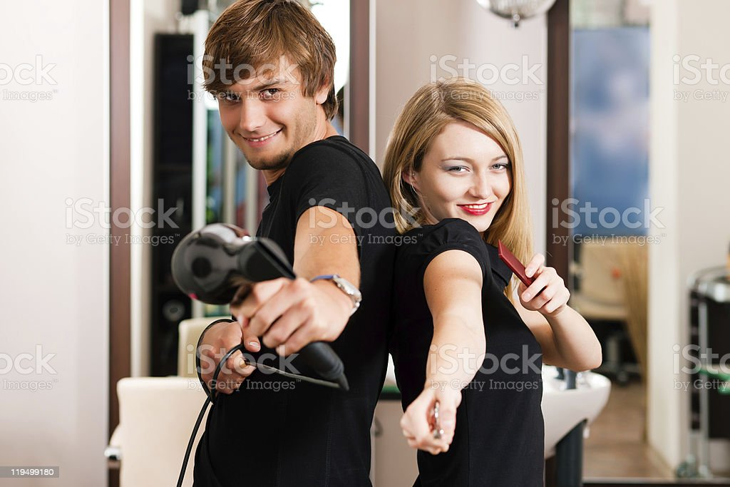 Male and female hairdresser royalty-free stock photo