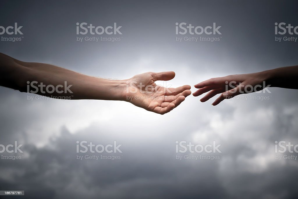 Male and female hands reaches out for help, copy space stock photo