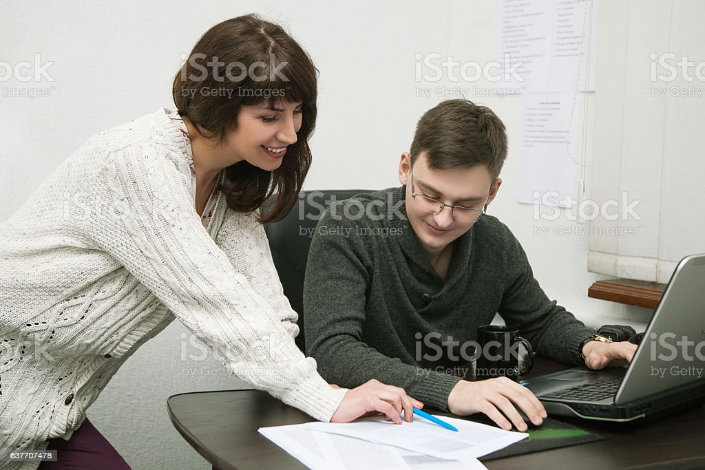 male and female in the office stock photo